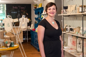 Sara pictured with a selection of her designs at her East Passyunk boutique, Occasionette.   Photo courtesy: Sean Corbett Photography